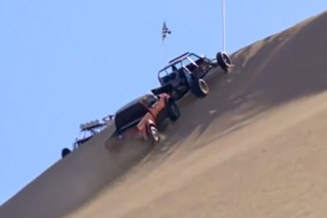 Nissan In Hot Water Over Ad Depicting Frontier Pushing Buggy Up Dune