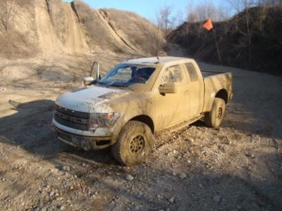 VIDEO: Automotive Journalists Get Stuck In Muddy Raptor During Test