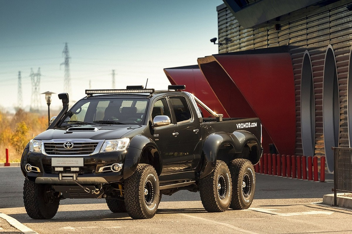 video toyota hilux gets an extra set of wheels for off road madness. Black Bedroom Furniture Sets. Home Design Ideas