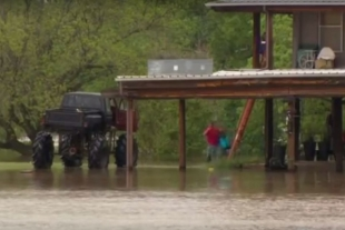 Video: Monster Truck Rescues Neighbors During Flood