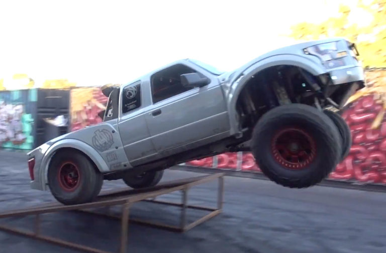Video: Class 1400 Truck Jumps Rat-Rod On Donut Garage